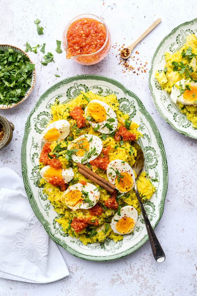 Kedgeree with smoked haddock and boiled eggs served in a platter with curried tomato sauce