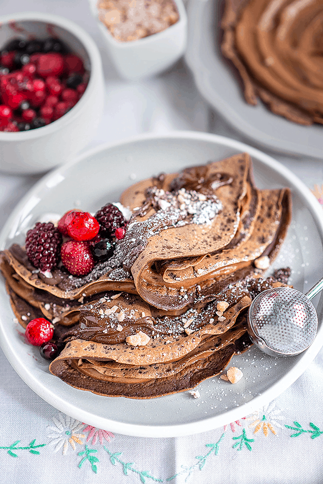 Chocolate crêpes with Nutella and mixed berries are perfect for an indulgent brunch or as a quick dessert.