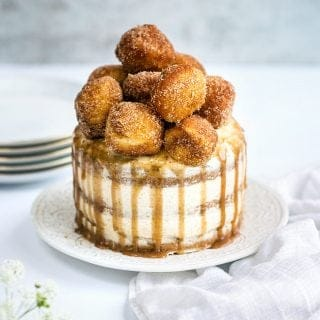 Sugar and spice and all things nice! Sugar and spice cake with mascarpone frosting and cinnamon caramel topped with mini doughnuts.