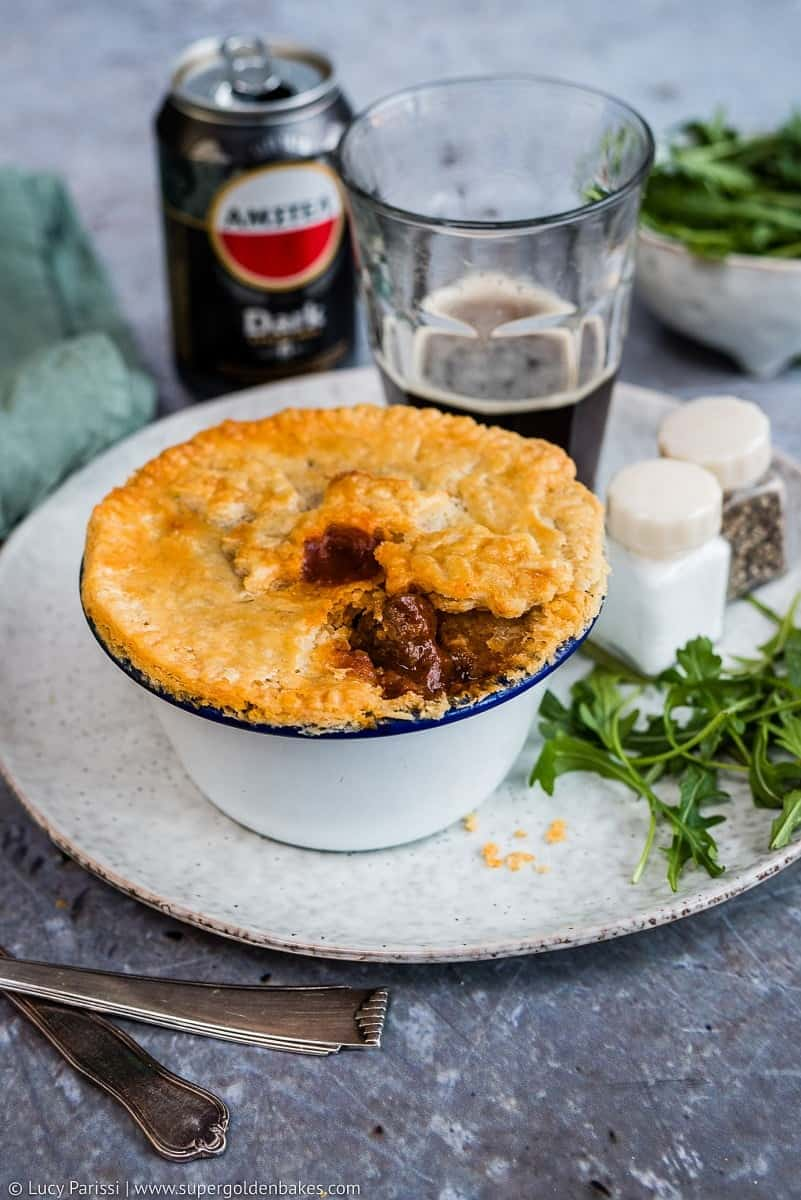 Beef and mushroom pot pies with thyme crust – individual mini-pies filled with delicious slow cooked beef and mushrooms in a dark beer gravy.