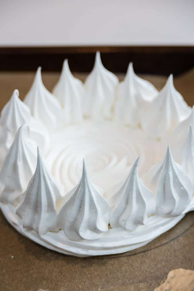 piping a meringue nest for pavlova