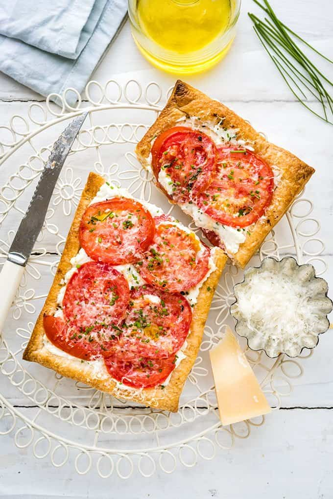 Puff pastry tarts with ricotta feta and tomatoes on a wire rack