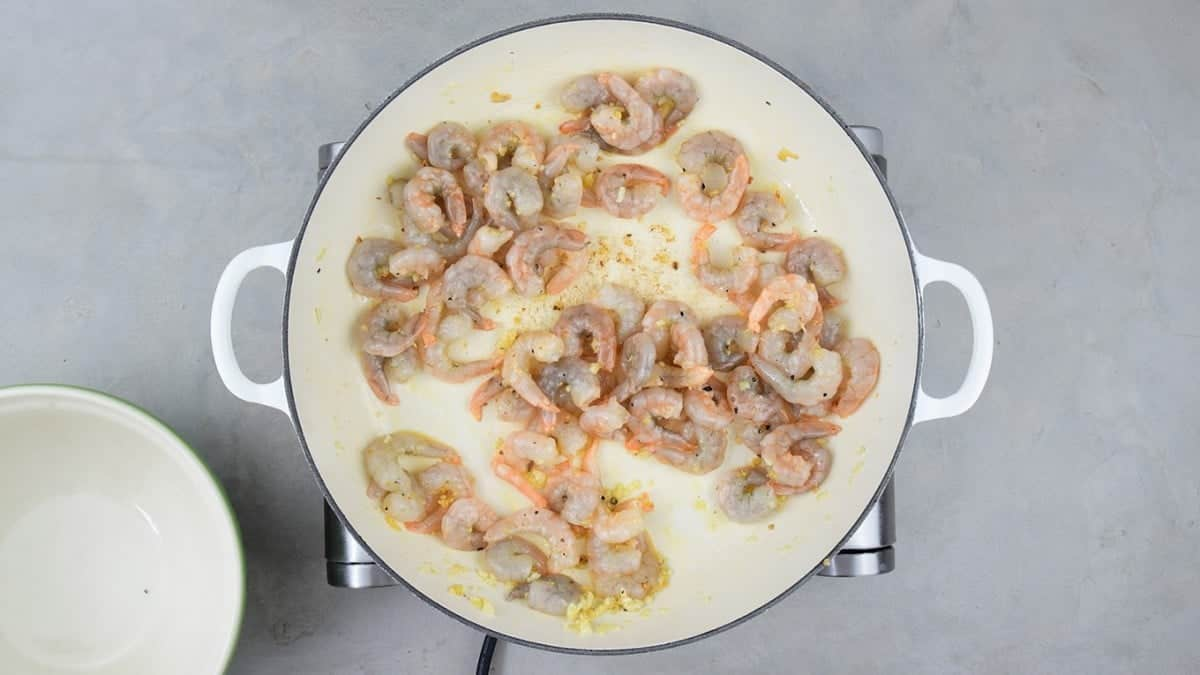 Cook garlic and shrimp