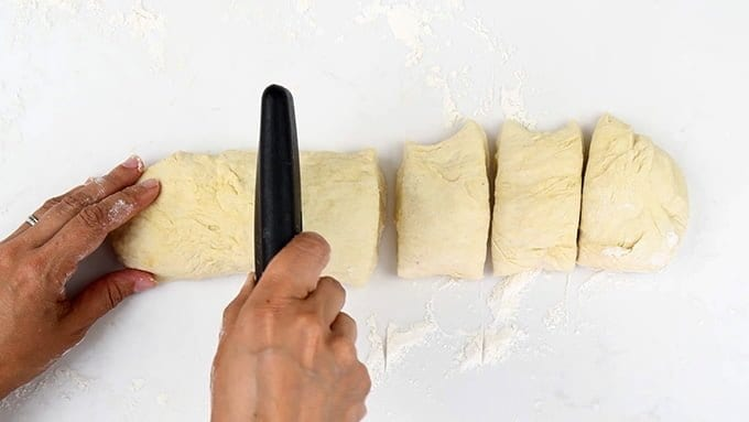 cutting pita dough into portions
