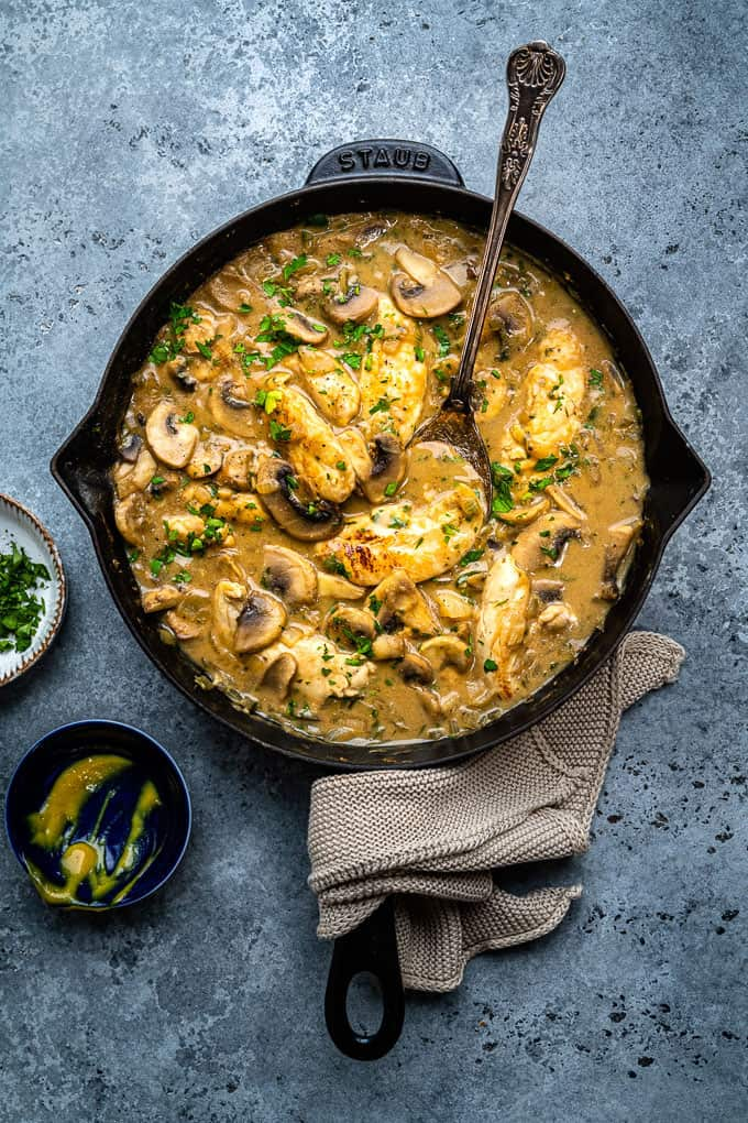 Skillet of Chicken Stroganoff on a blue grey background