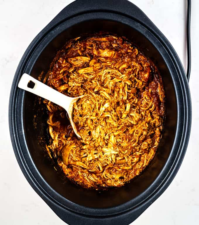 Shredded BBQ chicken in a slow cooker