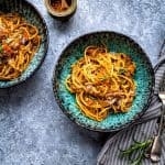 Lentil Bolognese served over wholemeal spaghetti in a bowl