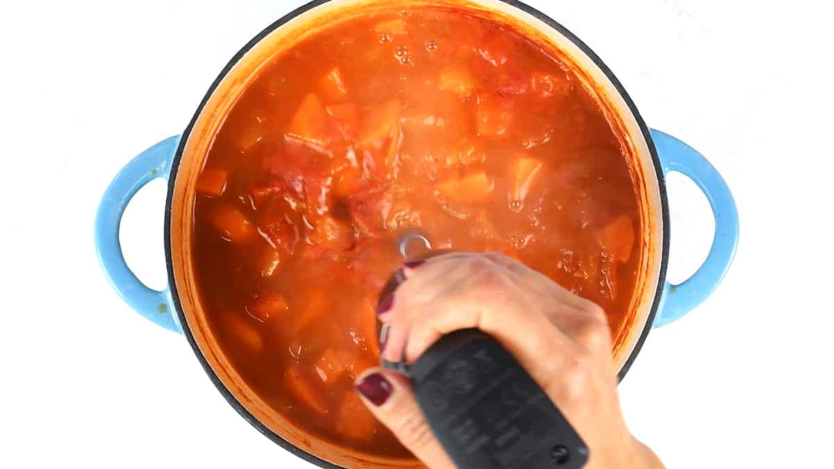 Blending tomato soup with an immersion blender