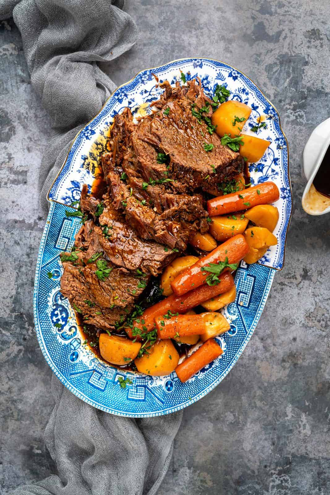 Platter of slow cooker beef roast with carrots and potatoes