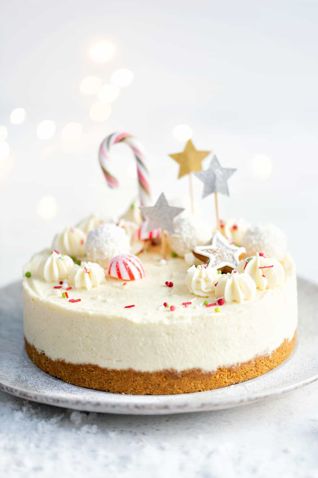 Christmas Cheesecake decorated with festive sprinkles and stars