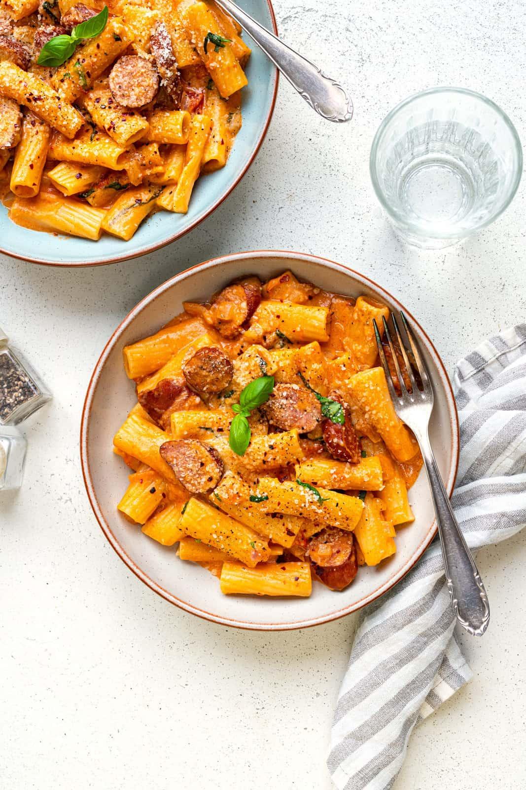 Bowl of sausage pasta in a creamy tomato mascarpone sauce
