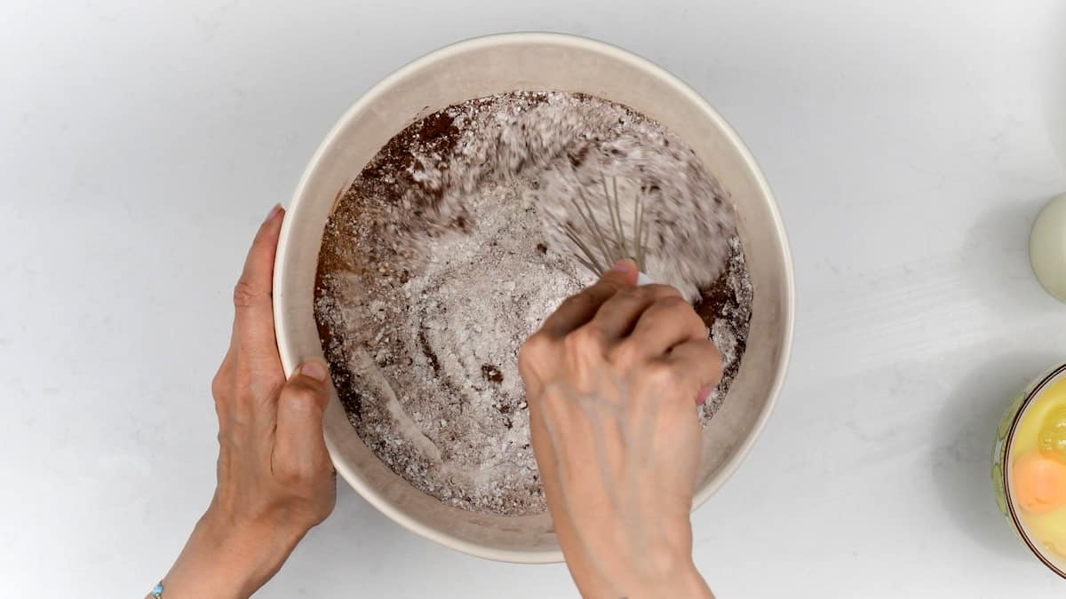 mixing flour, sugar, cocoa powder together in a bowl