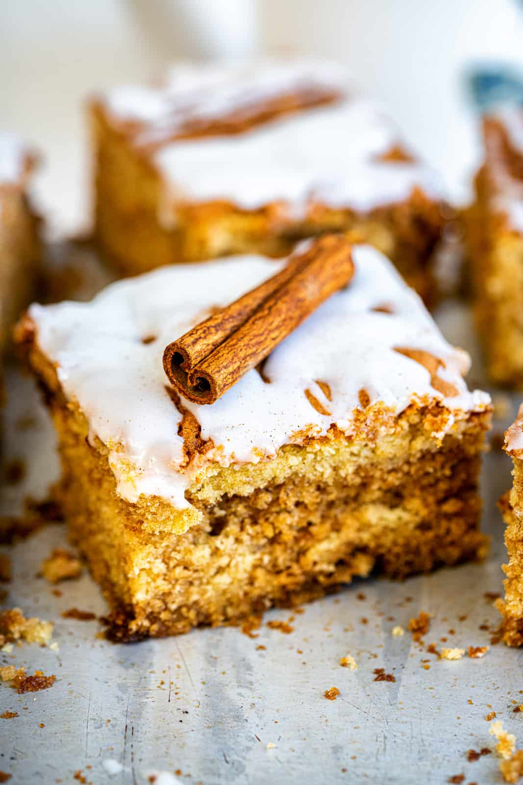 slice of cinnamon coffee cake decorated with cinnamon stick