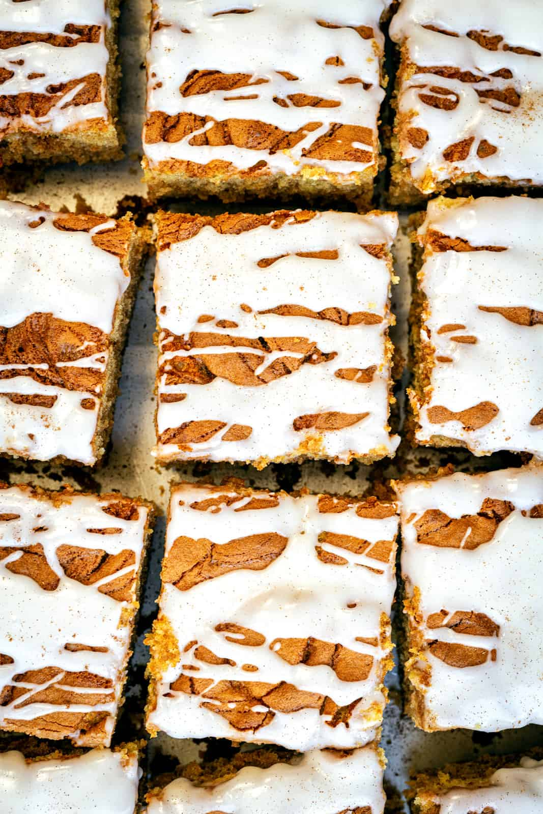 overhead close up of cinnamon coffee cake cut into squares