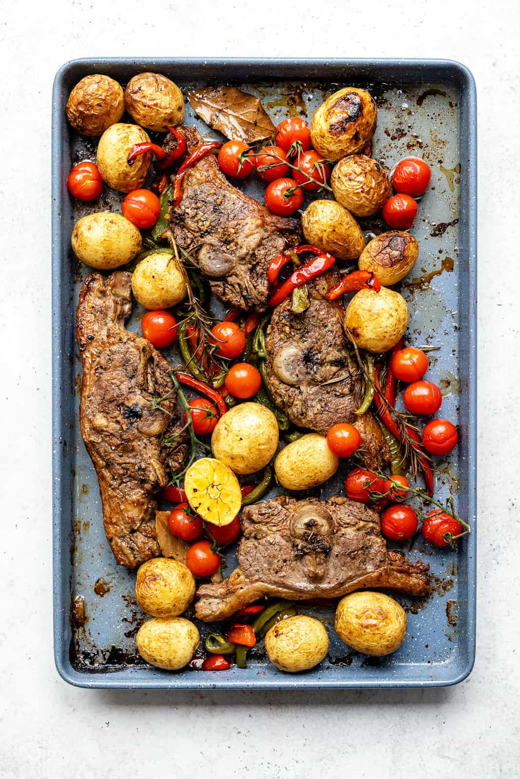 Oven Baked Lamb Chops with potatoes, peppers and tomatoes