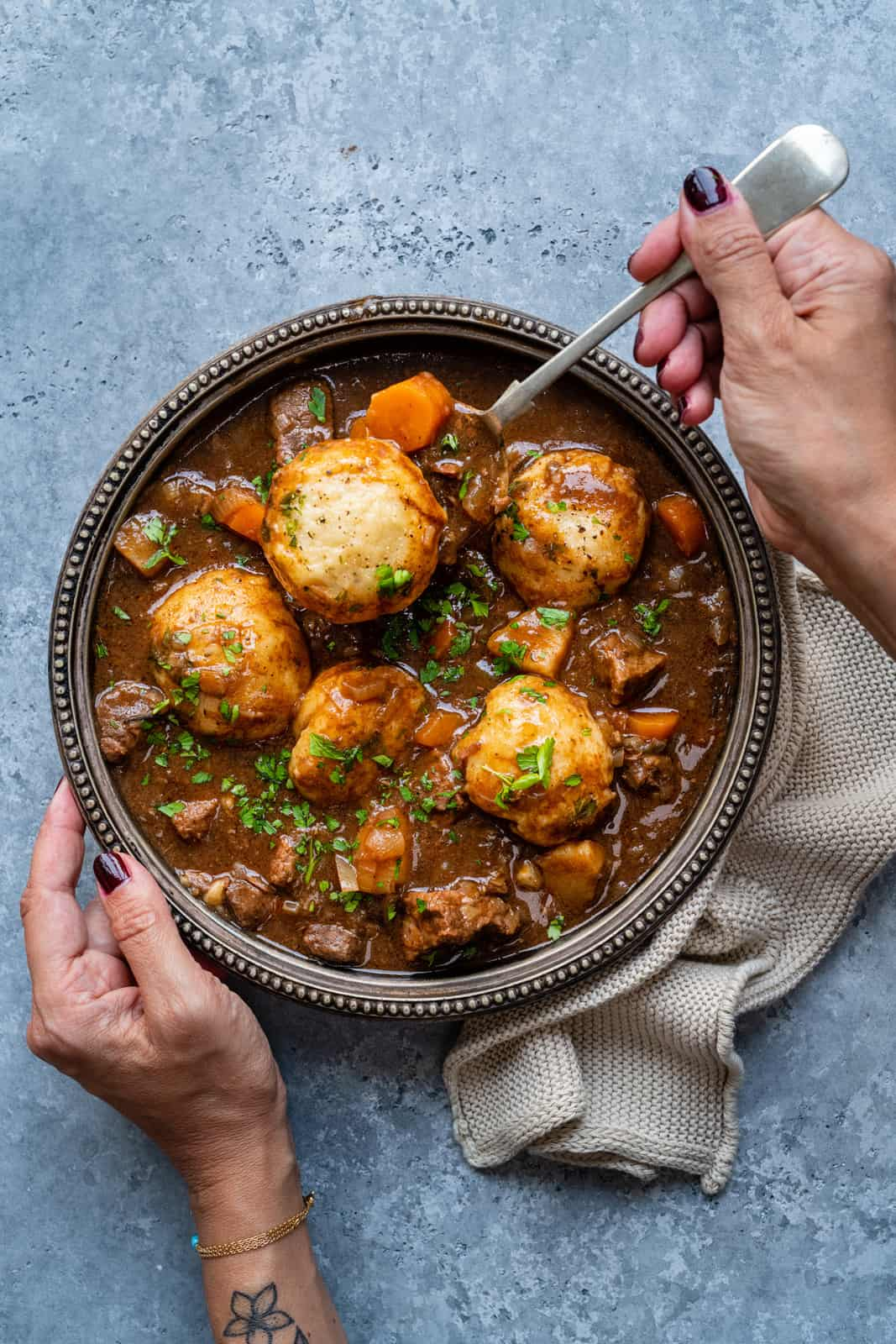 Beef stew with dumplings in a bowl