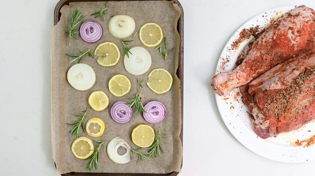tray with rosemary, lemon and onion slices